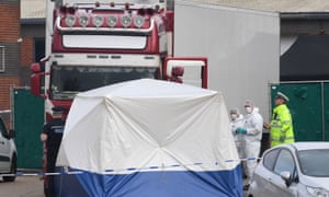 Police at an industrial park in Grays, Essex with a tent and police tape in the foreground