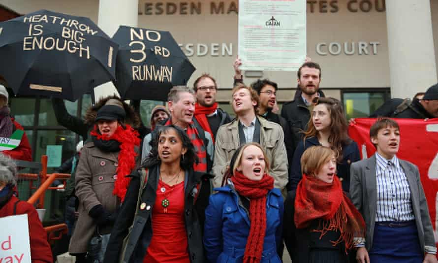 Plane Stupid activists at the start of their court hearing. The 13 were found guilty of aggravated trespass.