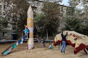 Children play in a park in the Kazakh city of Baikonur, which is administered by the Russian Federation and home to the Baikonur cosmodrome.