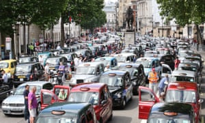 Black cab drivers stage a protest in London against the Uber taxi-booking app.