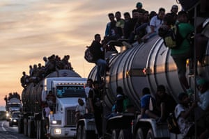 A truck carrying mostly Honduran migrants taking part in a caravan heading to the US drives from Santiago Niltepec to Juchitan, near the town of La Blanca in Oaxaca State, Mexico, on October 30, 2018.