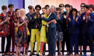 British designer Paul Smith is applauded by his models