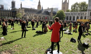 Musicians perform at a demonstration at London's Parliament Square against Covid-19 restrictions.