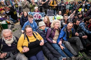 Groups staged a sit-down protest on Waterloo Bridge to highlight lack of action in climate change