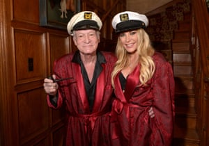 With his third wife Crystal Hefner