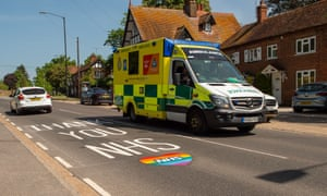 Coronavirus Covid-19 lockdown, Slough, Berkshire, UK - 09 May 2020Mandatory Credit: Photo by Maureen McLean/REX/Shutterstock (10641240c) An emergency ambulance from Wexham Park Hospital en route to a patient passes a new Thank the NHS sign painted on the road during the Coronavirus Pandemic lockdown. This one is near to Wexham Park Hospital where Coronavirus Covid-19 patients are being treated in the Intensive Care Unit and on specific wards Coronavirus Covid-19 lockdown, Slough, Berkshire, UK - 09 May 2020