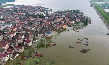 Buildings submerged in flood waters of Shijiu Lake on Sunday in Nanjing, Jiangsu province of China.