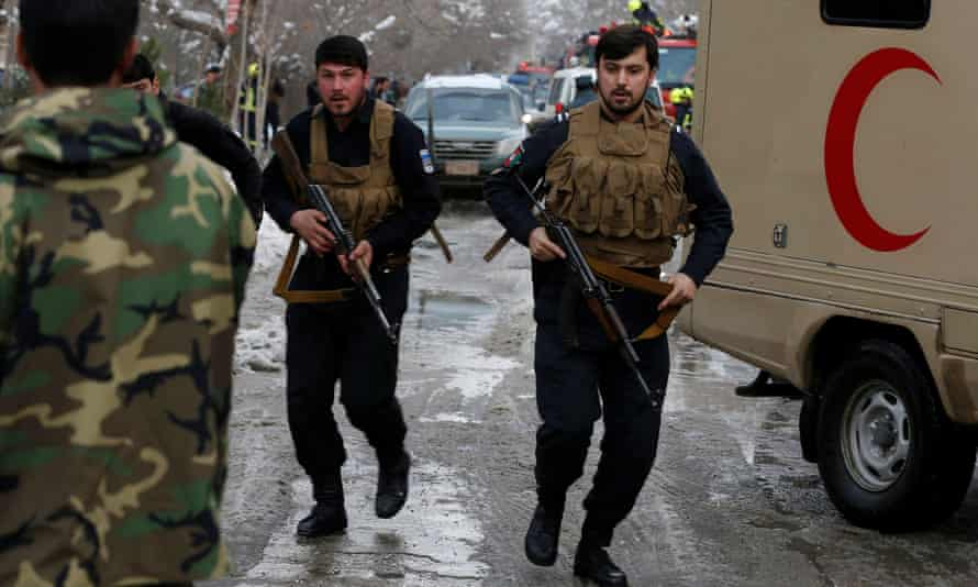 Afghan police officers arrive at the site of a bomb blast in Kabul.