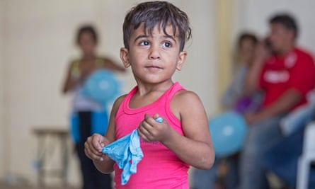 A Syrian refugee child in October, after coming ashore at RAF base Akrotiri in Cyprus.