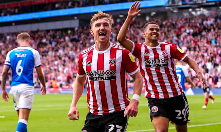 Ben Osborn celebrates as his two goals help Sheffield United to their first Championship victory.