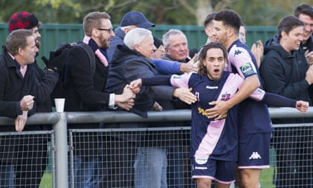 Dulwich Hamlet fans congratulate Reisse Allassani after he equalised in their 2-1 defeat at Harlow Town in Saturday's FA Trophy match.