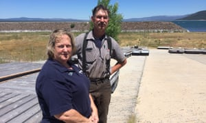 Grace and Scott McCullough on the boat ramp at Eagle Lake marina, once full of water.