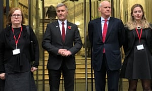 Richard Freeman (second left) where he posed for pictures after appearing at a hearing in Manchester.