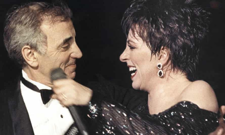 Liza Minnelli welcoming Charles Aznavour on to the stage at the end of her show at the Lido cabaret in Paris, 1987.
