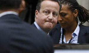 London, UK David Cameron is surrounded by police officers as he leaves 10 Downing Street to attend Prime Ministers Questions in Parliament