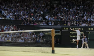 Roger Federer swishes a backhand to Berdych.