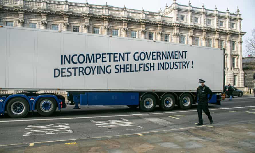 A slogan on one of the trucks says: 'Incompetent government destroying shellfish industry'
