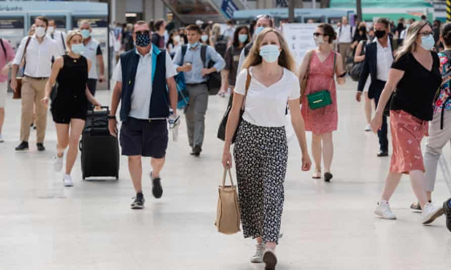 Commuters wearing face masks at Waterloo station in London on 19 July.