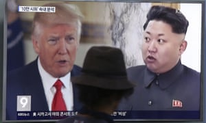 Donald Trump and Kim Jong-un shown on a TV screen