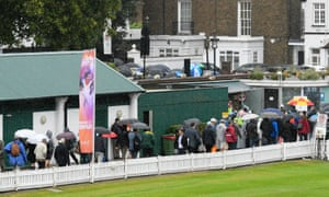 Spectators flood out of Lords as play is abandoned for the day due to the heavy rain.