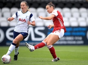 Arsenal's Caitlin Foord shoots the ball past Tottenham Hotspur's Anna Filbey to score her side's third goal.