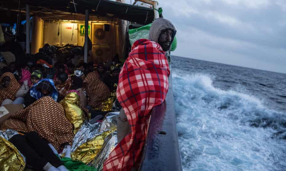 Refugees and migrants on the deck of the Spanish NGO vessel Golfo Azzurro. They are sailing towards the Italian port of Pozzallo after being rescued off the Libyan coast north of Sabratha in February. Rescuers saved 466 migrants in high seas
