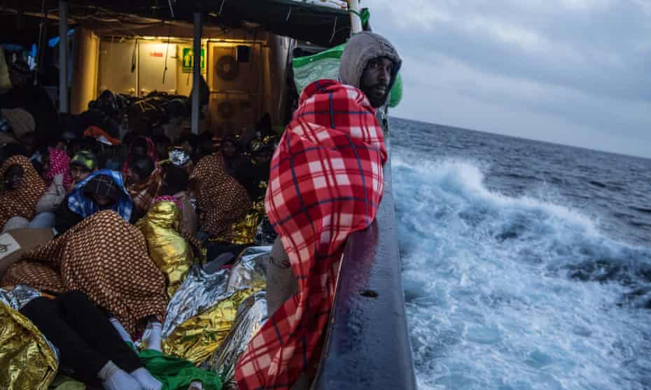 Refugees and migrants aboard the Golfo Azzurro after being rescued off the Libyan coast