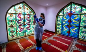 Bradford, England. Practice nurse Hannah Currie, 25, prepares a dose of the AstraZeneca vaccine as Bradford Central mosque is opened as a community Covid-19 vaccination centre