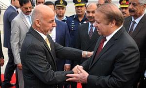 Afghanistan's Ashraf Ghani meets the Pakistan prime minister, Nawaz Sharif, at an airbase in Rawalpindi