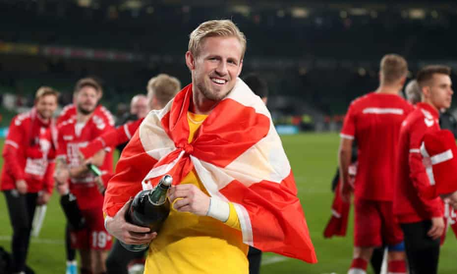 Kasper Schmeichel celebrates Euro 2020 qualification. The Leicester keeper will have a strong and settled back four in front of him.
