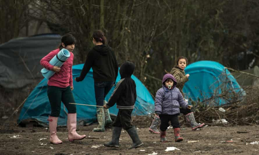 Migrants' children walk through the migrants camp of Grande-Synthe, near Dunkirk.