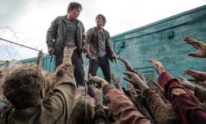 Michael Traynor as Nicholas and Steven Yeun as Glenn Rhee in The Walking Dead
