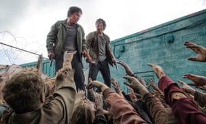 The threat of others … Michael Traynor as Nicholas and Steven Yeun as Glenn Rhee in The Walking Dead.
