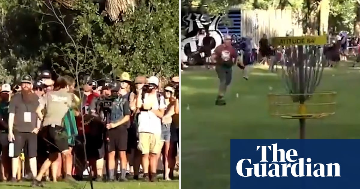 'Unbelievable': disc golfer throws 274ft birdie to push contest to a play-off – video