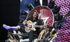 Toe hell and back … Dave Grohl in the stage throne he had built after breaking a metatarsal
