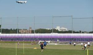 A plane takes off from nearby Chofu airport during an England training session.