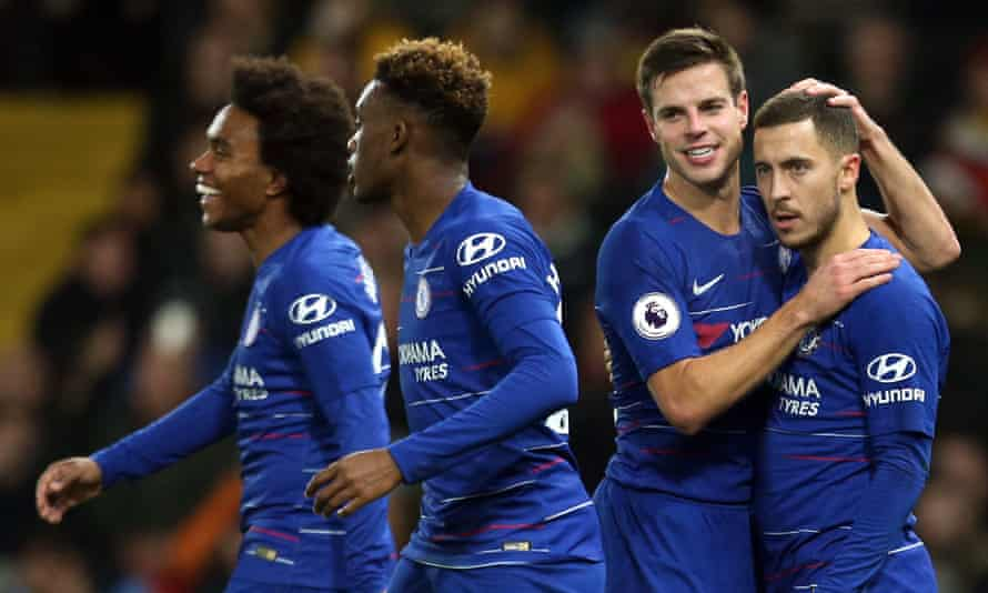 Eden Hazard is congratulated by his Chelsea teammates after scoring his side's winner at Watford from the penalty spot