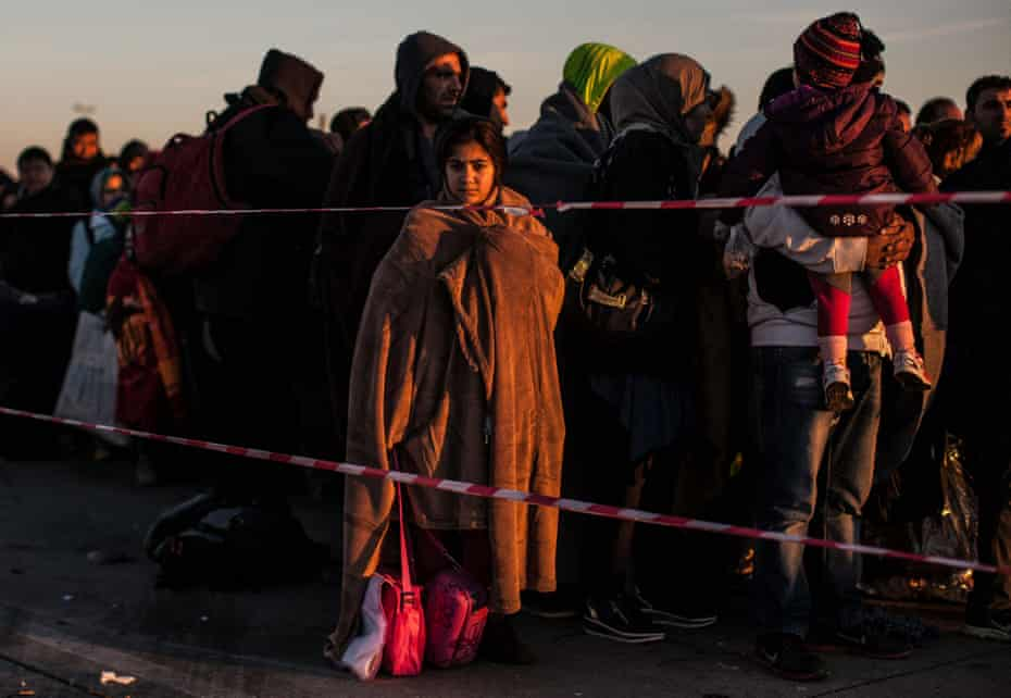 Refugees waiting to board buses at the Austria/Hungary border.