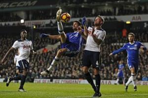 Diego Costa acrobatic effort is blocked by Toby Alderweireld.