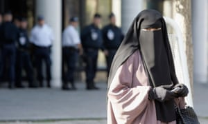 A woman leaves court after being convicted for wearing a niqab, Meaux, France, 2011