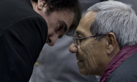Francisco Gómez, right, the man who raised Guillermo Pérez Roisinblit, talks to his lawyer during a trial against Gomez and the former head of Argentina's air force for the forced disappearance of Perez' biological parents.