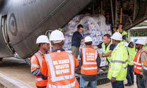 New Zealand military personnel unload aid supplies as part of emergency relief efforts in the Highlands region.