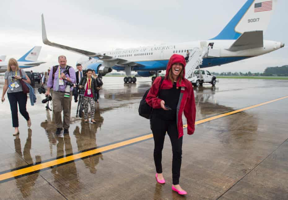 Beck Dorey-Stein walks from Air Force One with members of the White House press pool in Laos in 2016.