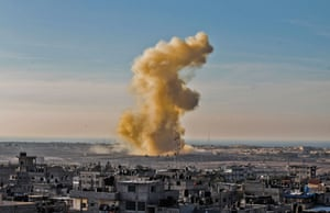 Smoke rises following an explosion close to the border on the Egyptian side of Rafah.