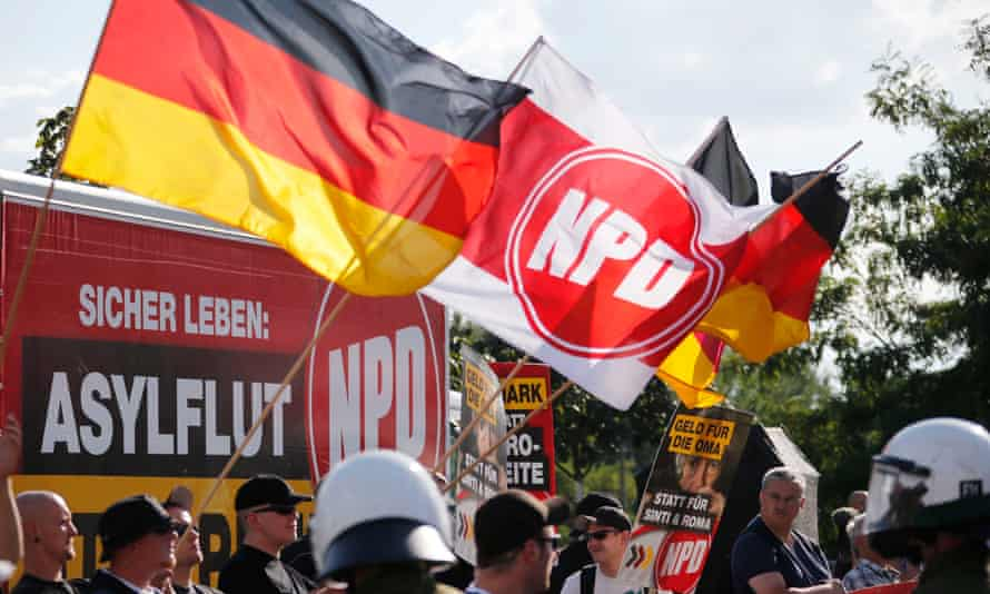 Far-right National Democratic Party protest against a refugee asylum in Berlin. The party is facing a ban at the constitutional court.