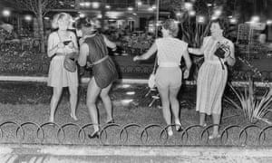 Women take photos of themselves in Ibiza.