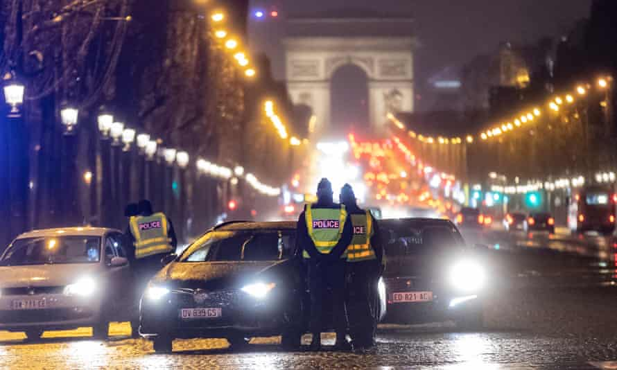French police at a checkpoint on the Champs-Élysées earlier this month to check drivers' authorisations to be outdoors beyond the 6pm curfew