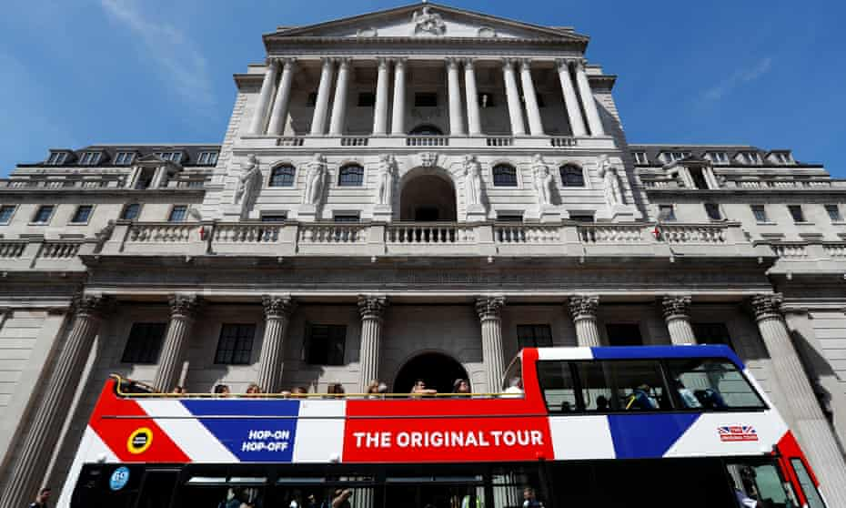 A tour bus passes the Bank of England in London