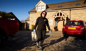 Milkwoman Margaret Lees delivering to the doorsteps of Ramsbottom in Greater Manchester. Her family firm's orders have doubled since Covid-19 struck.