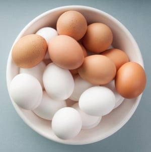 brown and white eggs in a bowl